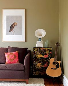 owl art and chocolate brown couch | photo: David A. Land