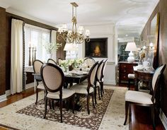 One of my favorite Candice Olson designs. Beautiful dining room with a fireplace high enough for everyone to enjoy and mirrored end walls for extra sparkle.  From an article on courant.com.