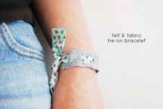 a fun little bracelet project with fabric strip, strip of felt, and hole punch