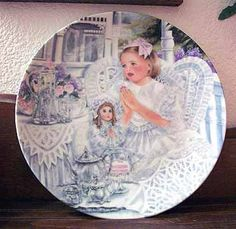 I fell in love with this beautiful porcelain plate. I found it in this great Treasury:  http://www.etsy.com/treasury/MjE3NDM0NjR8MjcyMzgzNTY5OA/open-promote-a-shop-the-movie-scroungers?page=2#comments