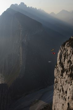 Miles Daisher with Julian Boulle and J.T Holmes B.A.S.E jumping with wingsuits from Independencia Peak during Adrenalina Nuevo Leon in Monterrey, Mexico.