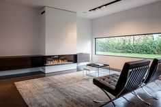 Bosmans Haarden - Fire place. Love this space. Minus those chairs