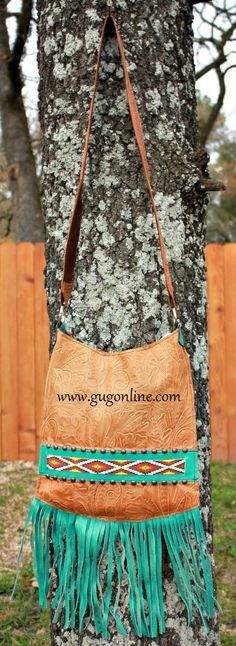 KurtMen Designs Cross Body Tan Tooled, Ivory and Turquoise Beaded Design and Silver Studs, Turquoise Fringe and Tan Tooled Back Purse Shop now at www.gugonline.com