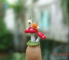 micro crochet snail and mushrooms
