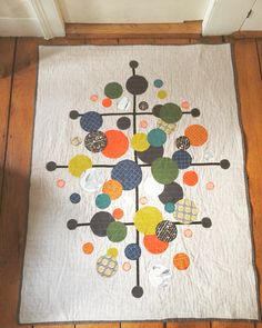 The Eames Curtis Jere 'Radiate' Quilt. Baby quilt. Linen & cotton. Aurifil 50 weight thread. Carolyn Friedlander fabrics: Doe, Carkai & Architextures. Art Gallery fabrics. Inspired by midcentury modern print by Curtis Jere. Made by White Hills Quilts.