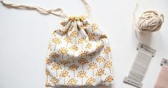 This tutorial will show you how to make a simple drawstring bag.