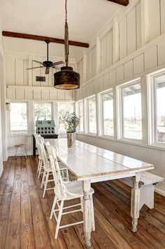 creative light fixtures out of old farm implements - Sunroom Dining Room