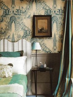 Cream and blue architectural toile wallpaper, French curtains. Lovely bedroom.