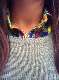 colorful button-up under gray sweater.