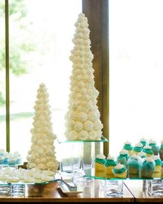 Table anchored with meringues wrapped around tall foam forms.