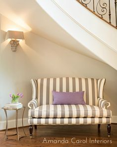 white and gray striped settee