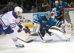 San Jose Sharks goaltender Alex Stalock stretches out to rob Edmonton Oilers forward Leon Draisaitl of a goal (Dec. 9, 2014).