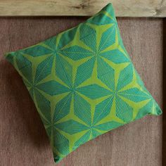 HAND-BLOCKED DIAMOND FLOWER PILLOW COVER. Our gray couch could certainly use some color.