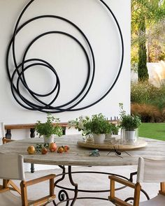 OUTDOOR dining under Canogar sculpture, Cadiz, Spain. Designed by architect Pedro Riveiro Pita.