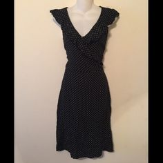 Black and white polka dot faux wrap ruffle dress Black and white polka dot faux wrap ruffle dress. Zipper on the side. 39 1/2 inches long. Button in bust to keep from showing too much cleavage. Rayon. Tag reads size 8. H&M Dresses Midi