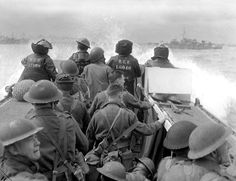 Canadian soldiers in a Landing Craft Assault (LCA) head for the beachhead from HMCS Prince Henry during the Allied D-Day landings in Normandy [1172 x 903]