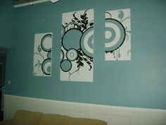 """Fill up your huge wall (or any wall), I built  these """"canvas"""" out of sheets of plywood and 1x1 frame on the back to have it come off the wall like a real canvas, create a design on your computer (or find one online) and project it onto the wood and paint! Super awesome custom artwork to perfectly match your decor!"""