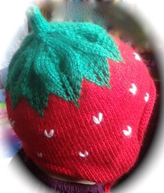 This is a variation of a Strawberry Hat design. I added the earflaps and shaped myself the leaves pattern. It stays on my daughter's head beautifully.