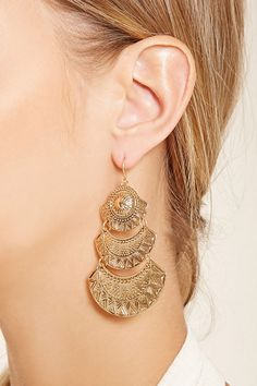 A high-polish pair of drop earrings with fish hook backs and tiered geo etched plates.