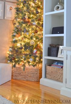 Under The Table and Dreaming: From Our House to Yours - Christmas Decor 2012 -- Xmas tree in a basket instead of covered with tree skirt.