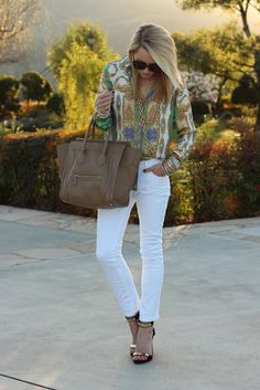 White pants with something colorful on top...