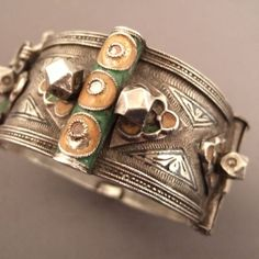 """Silver, enamel, niello, Morocco   Description  This old  Moroccan Berber cuff  was worn by the bride and, as a part of their personal dowry, they remained to them during all their life… this bracelet dates from first half of the 20th century...  Weight:108,05gr    Height:1,29 inch    Diameter::2,32inch    www.halter-ethnic.com...see """"My Lucky Finds"""""""