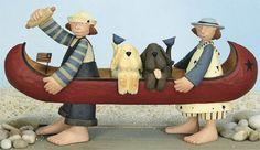 WilliRaye Studios Kids & dogs in a boat.