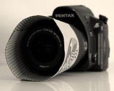 Use a coffee cup sleeve as a cheap and simple DIY lens hood.