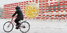 A man rides his bicycle on a snow-covered road in Changchun, Jilin, February 21, 2015.  Changchun witnessed its first snowfall of Chinese Lunar New Year Saturday