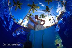 valdorama.com, artistic underwater afterglow post wedding photo session, Majestic Elegance, Punta Cana, Dominican Republic, pool, dress, kissing, blue, palm trees, ripples