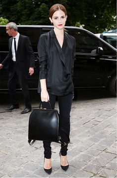 Emma Watson in a chic and timeless black silk blouse, pumps and red lip