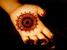 Henna. Seems easy enough to do on your right hand...