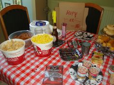 White Trash Party!   Great for the Summer and for your wallet, I went to the local KFC and picked up a few chicken buckets to hold chips and things, not the good kind! (porkrinds,cheese ballz,and corn flavored cheezies) A cake I towered wagon wheels, twinkies and honey dounuts. also put out things like jerky, cocktail hotdogs still in the can and we even made Spam Skewers on the BBQ. used paper plates from all occasions. Had beer bottle candle holder's. every one dressed up, it was a blast