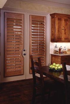 Norman wood door shutter with cutout. Shutters are an unobtrusive solution for french doors. Available at Budget Blinds! Custom Shutters, Vinyl Shutters, Window Shutters, Window Blinds, French Doors Bedroom, French Door Curtains, French Door Coverings, Window Coverings, Classic Shutters