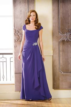 Jade J175068. Store Sample in Concord Grape, Size 10 and Noir, Size 20. Chic and stylish, this Georgette mother-of-the-bride dress is perfect for your next special occasion. This gown has a unique square neckline, flowing A-line skirt, criss cross ruched bodice, and beaded detailing at the waist. #InWhiteSpringfield