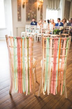 Peach and mint green ribbons decorating bride and grooms chairs  Photography by http://photography34.co.uk/