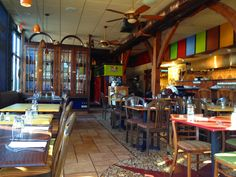 Cafe Ena in Minneapolis - Love the interior colors, rustic wood, tiling, custom glass-fronted/stained cabinetry, metals. Earthy and Latin-inspired.