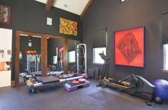 Bright artwork on the walls adds color to the dark room