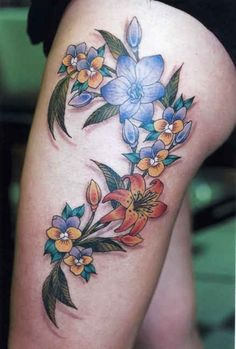 Thigh Tattoo # 129 - Never seen gorgeous colorful feminine flower tattoo design like this on thigh. This thigh tattoo is amazingly beautiful:)