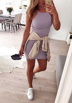 Girl in lavender 90s-style neck bodycon dress and white sneakers
