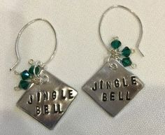 Quick, get these in time for your holiday bash! Adorable stamped JINGLE BELL EARRINGS with 3 green swarovski crystals on each ear. The dangle is 3″, and the aluminum stamped square measures 1 1/2″. $24.00. email julieboscarino@gmail.com to purchase.