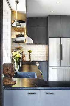 I love soapstone counters! (Before & After: A Williamsburg Kitchen Turns Around — Sweeten)