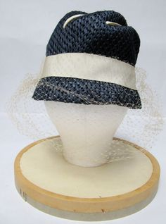 1960's Blue Straw Hat with Ivory Grosgrain Ribbon and Attached Ivory Netting. $150.00, via Etsy.