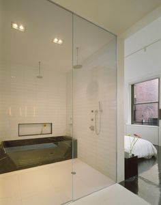 Apartement Black Marble Tub Among Shower Matched With White Tiled Walling Interior Color Theme in Loft Interior for Creative Mind