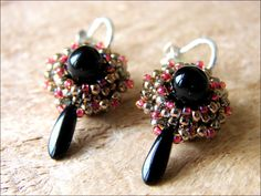 It's Free Pattern Friday! Visit the Craftsy blog to download the FREE pattern for these lovely beaded earrings!