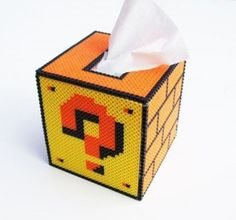 question mark block kleenex box made from perler beads (hama beads or fuse beads). Already started making the front! Tissue Box Covers, Tissue Boxes, Fuse Beads, Perler Beads, Crochet Mario, Deco Gamer, Mario Room, 8bit Art, Pot A Crayon