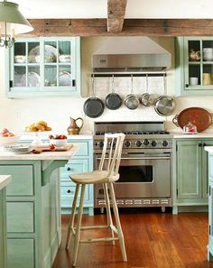 """36"""" Viking Range with wooden cabinets in a happy shade of blue! @Adore Your Place has some great tips for selecting a color for your kitchen cabinets!"""