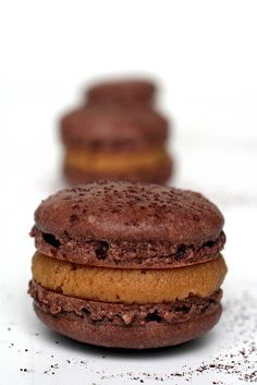 Butter Cup Macarons - Ari's Menu - Peanut Butter Cup Macarons … -Peanut Butter Cup Macarons - Ari's Menu - Peanut Butter Cup Macarons … - A luscious chocolate macaron filled with caramel and toasted coconut. The Secret of Macarons by José . Chocolate Macaroons, French Macaroons, Chocolate Ganache, Chocolate Roulade, Chocolate Smoothies, Chocolate Shakeology, Chocolate Crinkles, Chocolate Drizzle, Chocolate Caramels