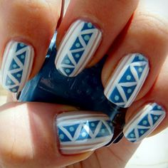 Blue tribal nails.