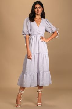 This lovely lavender midi also comes in a dusty rose color that's beautiful. Wear this dress with sneakers or flat sandals for shopping with the girls and dress it up with heels, jewelry, and a sparkly clutch for a rehearsal dinner. #weddingguestdress #weddingguestoutfit #rehearsaldinnerdress #dressestoweartoawedding #southernliving Halter Neck Maxi Dress, Ruffle Dress, Rehearsal Dinner Dresses, Dress With Sneakers, Mini Dress With Sleeves, Buy Dress, Long Sleeve Sweater, Flare Dress, Lavender